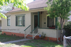 Front of home including porch and porch swing