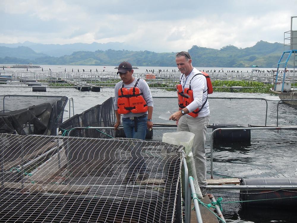 Encore Seafoods CEO Matt Mariani, right, tours Royal Springs tilapia farms