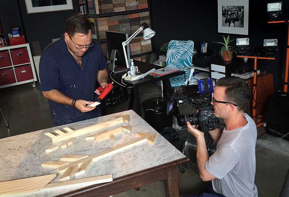 James Treble preparing props for a design challenge for The Living Room