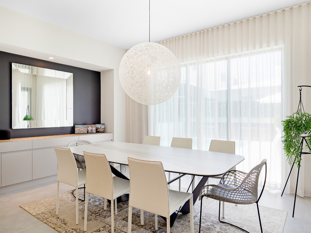 light furniture and reflective surfaces help increase the amount of natural light in any space