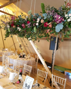 HAnging flower display over the top table at Brinkburn Priory Tipi wedding in Northumberland