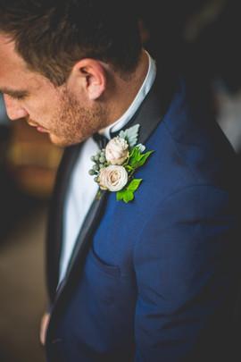 Blush Rose Buttonhole and Blue Suit