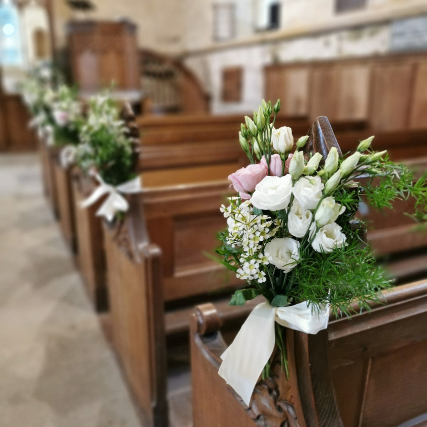 Covid19 safe church micro wedding at St Wilfreds Church in kirkharle Northumberland. Pew end aisle flowers with scented white flowers David Austin Roses, light pink spray roses and blue delphinium. Floral Quarter Wedding Florist