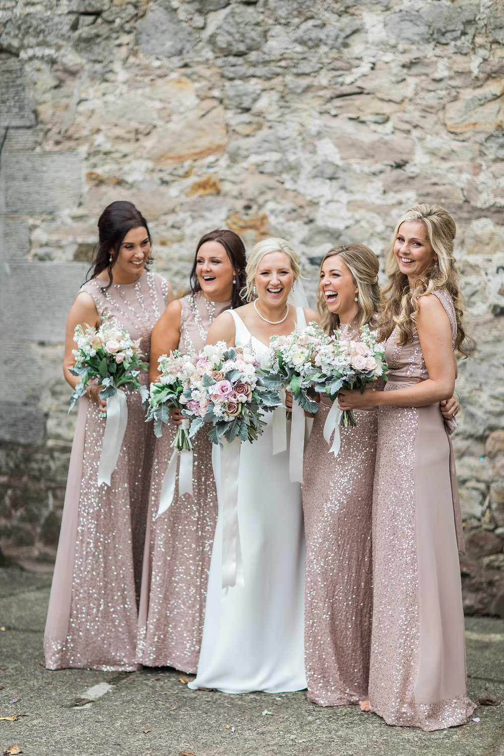 Hand Tied blush, nude and white bridal bouquet wedding flowers at Doxford Barns in Northumberland. Image by Emily Hannah Photography