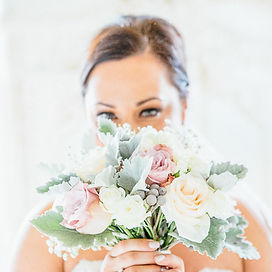 Bride holding wedding flower bridal bouquet blush pink roses newton hall