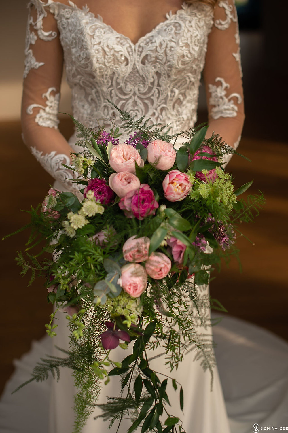 Trailing Cascading Bridal bouquet wedding flowers at Harewood House Yorkshire . Image by Soniya Zeb PHotography