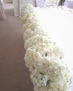 Stunning full length white flower top table flowers at Seaham Hall