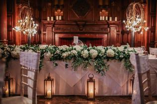 Stunning full length top table flowers in white and green, at Jesmond Dene House In Newcastle