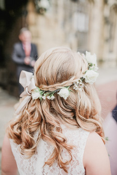 Flowergirl wearing a delicate white rose flower crown at ST Michaels Church in Alnwick