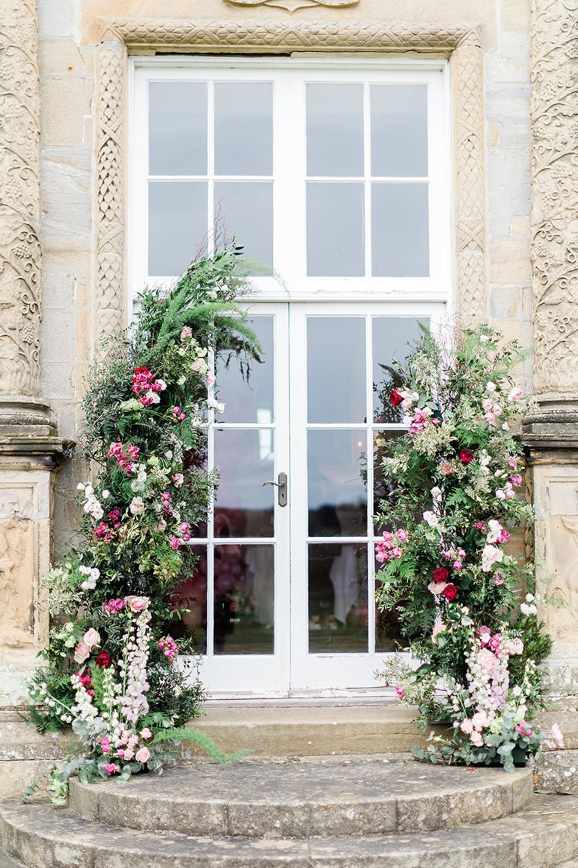 Large Floral columns at capheaton hall northumberland wedding ceremony
