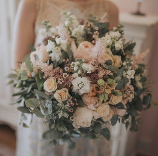LArge and luxurious textured bridal bouquet, white, peaches and greens, at HEaley Barn Northumberland