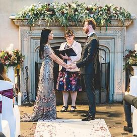 Asian english wedding matfen hall northumberland wedding flowers fireplace