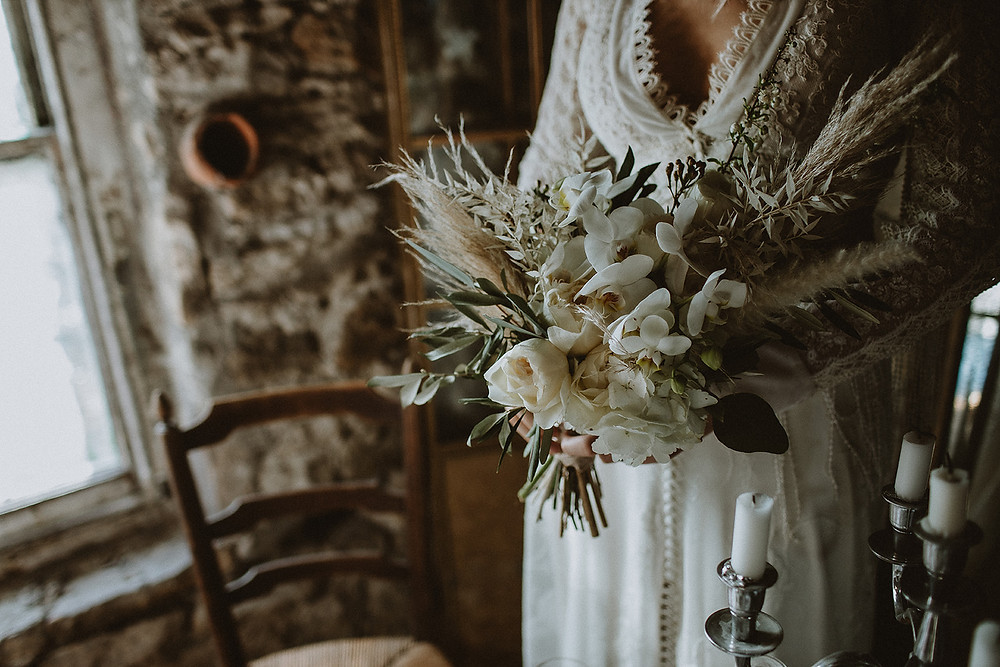 Bride & Groom in Northumberland. Beautiful rustic and luxurious bouquet of dried flowers, pampass grass, orchids and roses with buttonhole to match