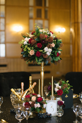 Luxe gold and red centrepiece flowers for a city wedding at Vermont Hotel Newcastle