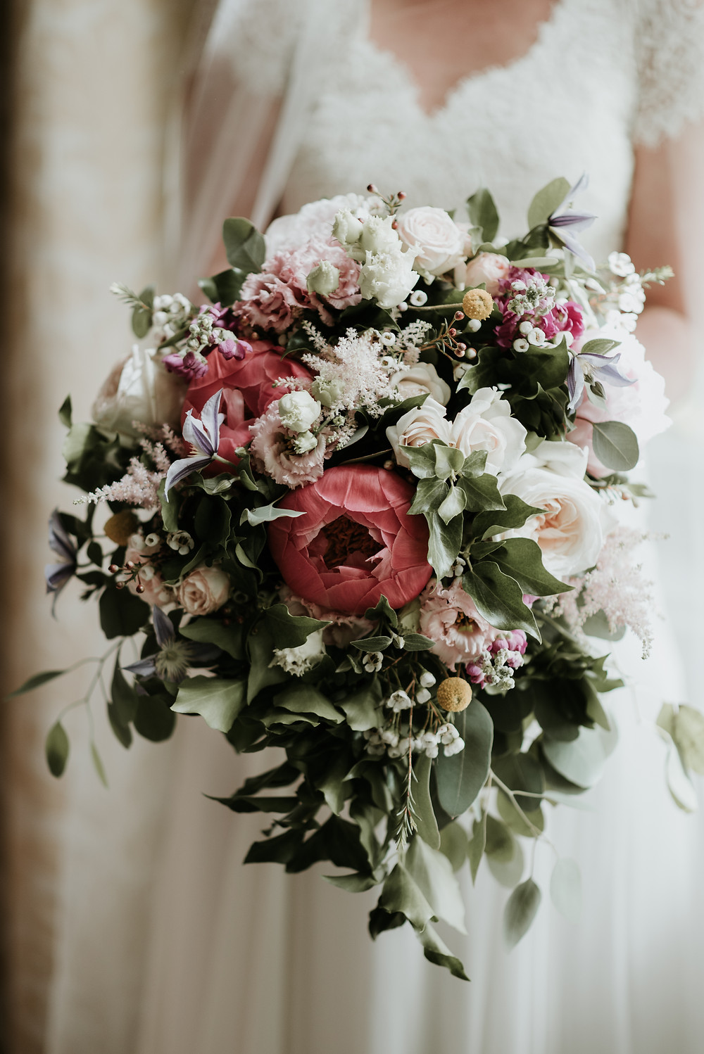 Cascading loose hand tied Bridal bouquet at Matfen Hall Wedding in Northumberland. Image by Jamie Mac