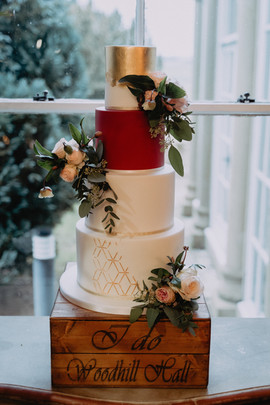 Red & Gold wedding cake with fresh flowers at Woodhill Hall Northumberland