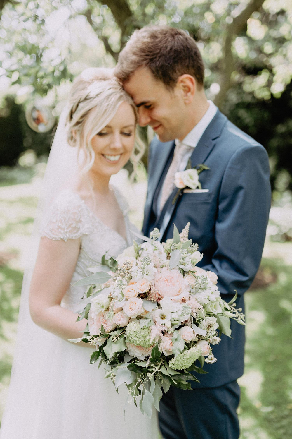 Bride and groom at crook hall gardens. image by paul liddement