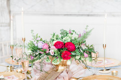 Romantic and flowing centrepiece flowers in our gold containers at Capheaton Hall