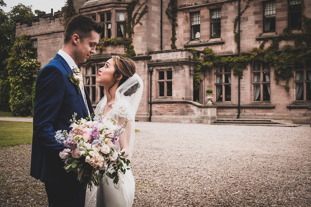 Natural Hand Tied  Pastel Coloured Bridal Bouquet wedding flowers at Ellingham Hall Northumberland
