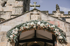 Pretty Church floral arch at St Michaels Church in Alnwick Northumberland
