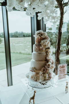 Luxe wedding cake with fresh flowers at Charlton Hall Northumberland