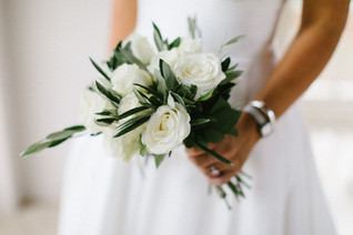 Simple and classic white Rose and foliage bridal bouquet at Newby Hall Orangery