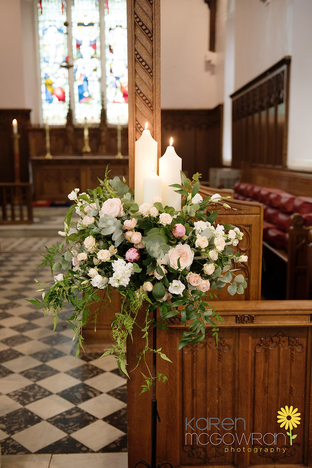 Pedestal arrangement with candles at a church wedding ceremony in Seaham