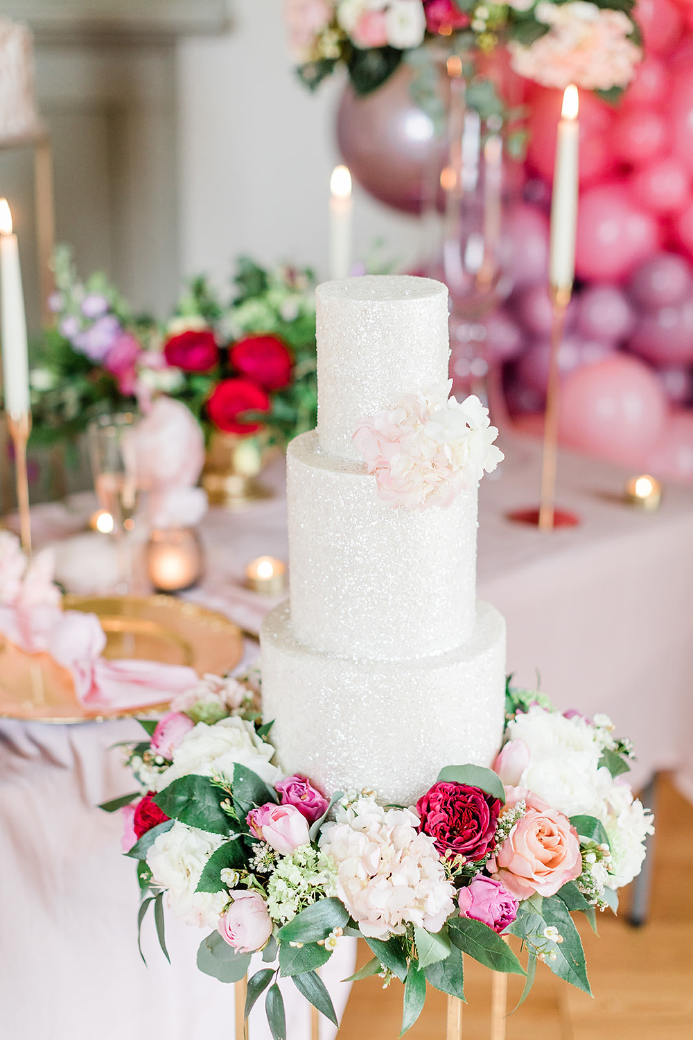 Table Beautifully decorated for a wedding meal with flowers, centrepieces, props in gold and pink. Capheaton Hall Northumberland. wedding Cake