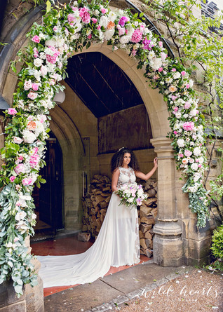Dramatic floral arch at the entrance to Jesmond Dene House Newcastle