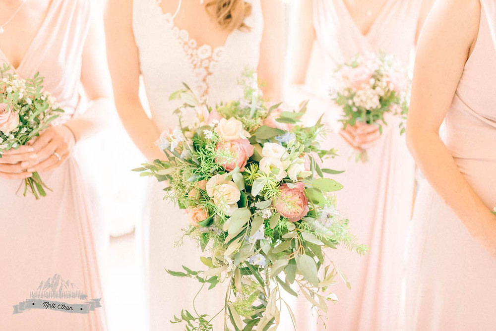 Wild Cascading Bridal Bouquet in Blush white and green at NEwton Hall Northumberland. Image by Matt Ethan