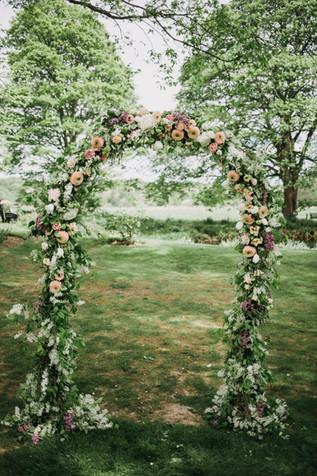 Pretty floral wedding arch at Crook Hall Durham