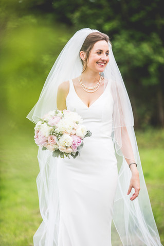 White and blush Bridal bouquet at Ellingham Hall Northumberland