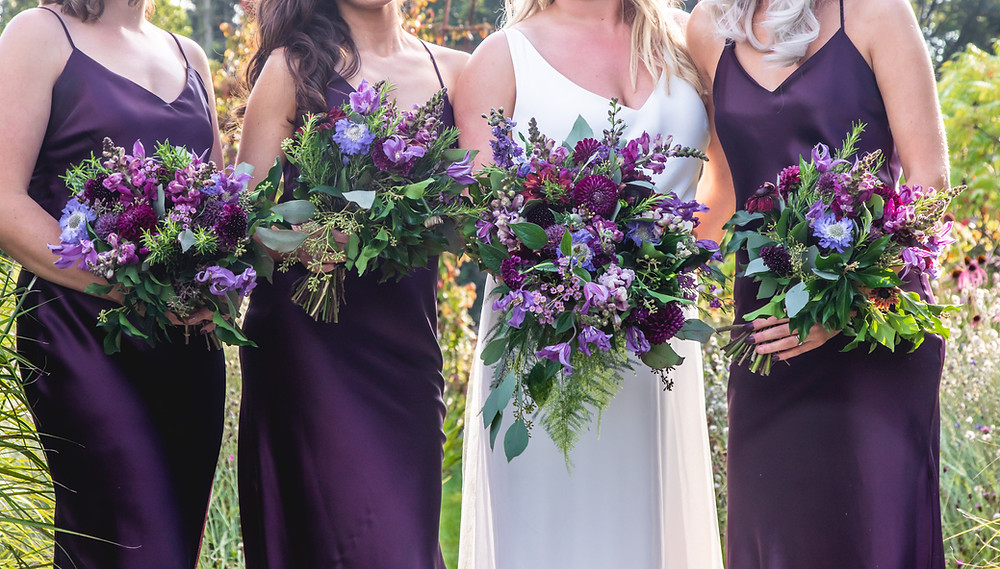 Purple, Burgundy, Aubergine cascading Bridal Bouquet and Bridemaids at Middleton lodge Fig House Wedding in Richmond Yorkshire. Image by Elaine Slipper for Sean Elliott Photography