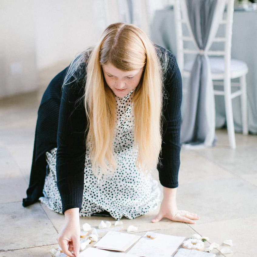 Gray Starling Wedding stationery creating a flatlay with my flowers at our photoshoot at stunning Yorkshire wedding venue Newby Hall Orangery
