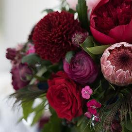dark red wedding flower centrepiece woodhill hall