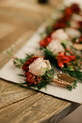 Rustic Autumnal buttonholes with copper wire wrapped around, at Woodhill Hall