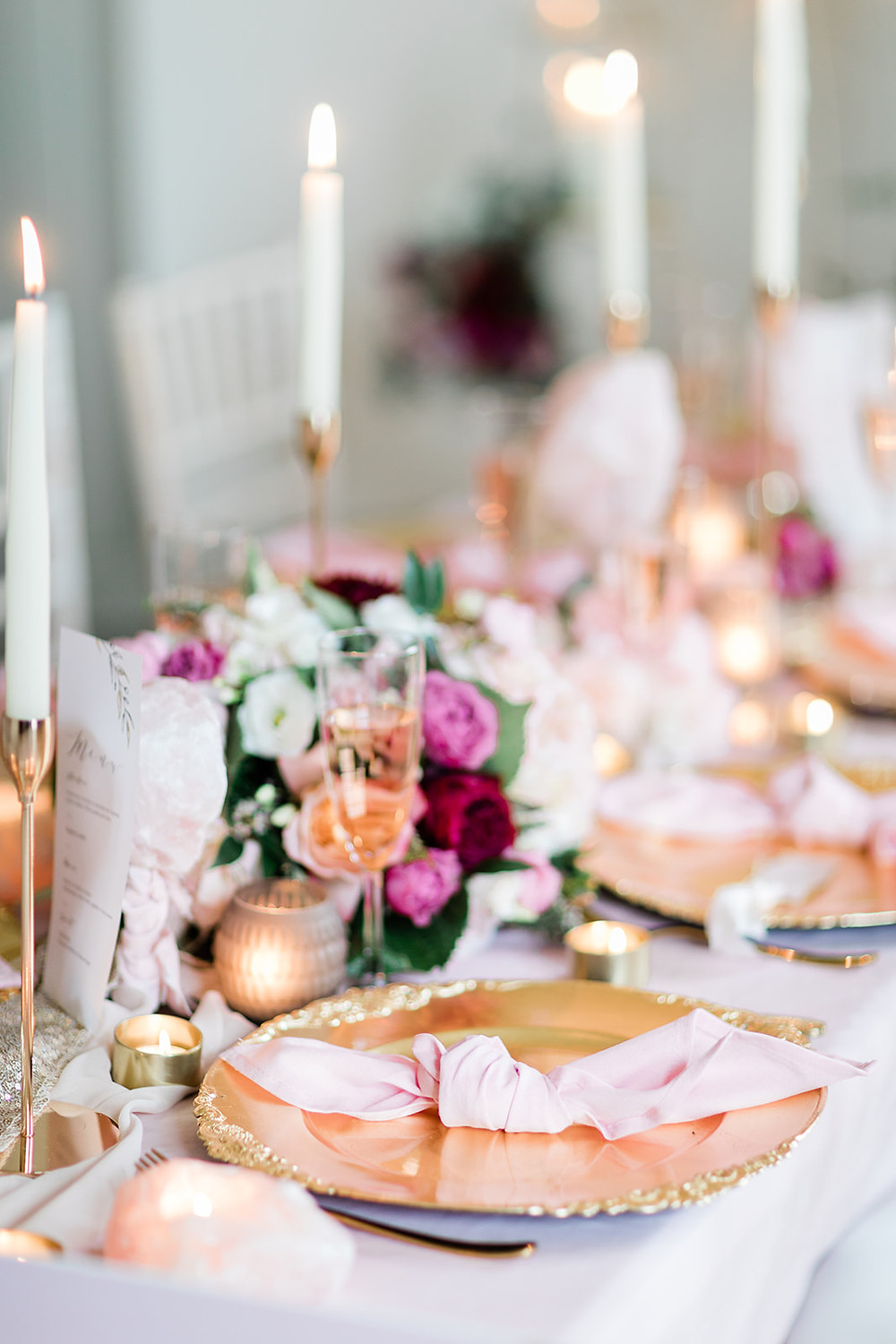 Table Beautifully decorated for a wedding meal with flowers, centrepieces, props in gold and pink. Capheaton Hall Northumberland