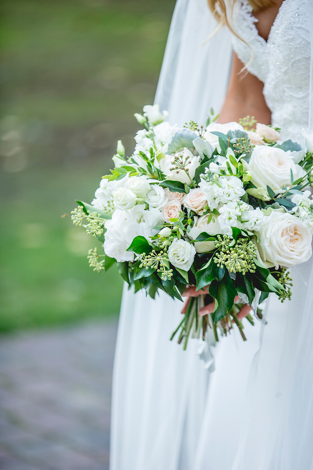 Hand Tied white, blush and green Bridal bouquet wedding flowers at MAtfen Hall Northumberland. Image by Sean Elliott Photography