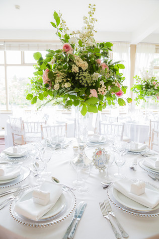 Large relaxed wedding table centrepiece