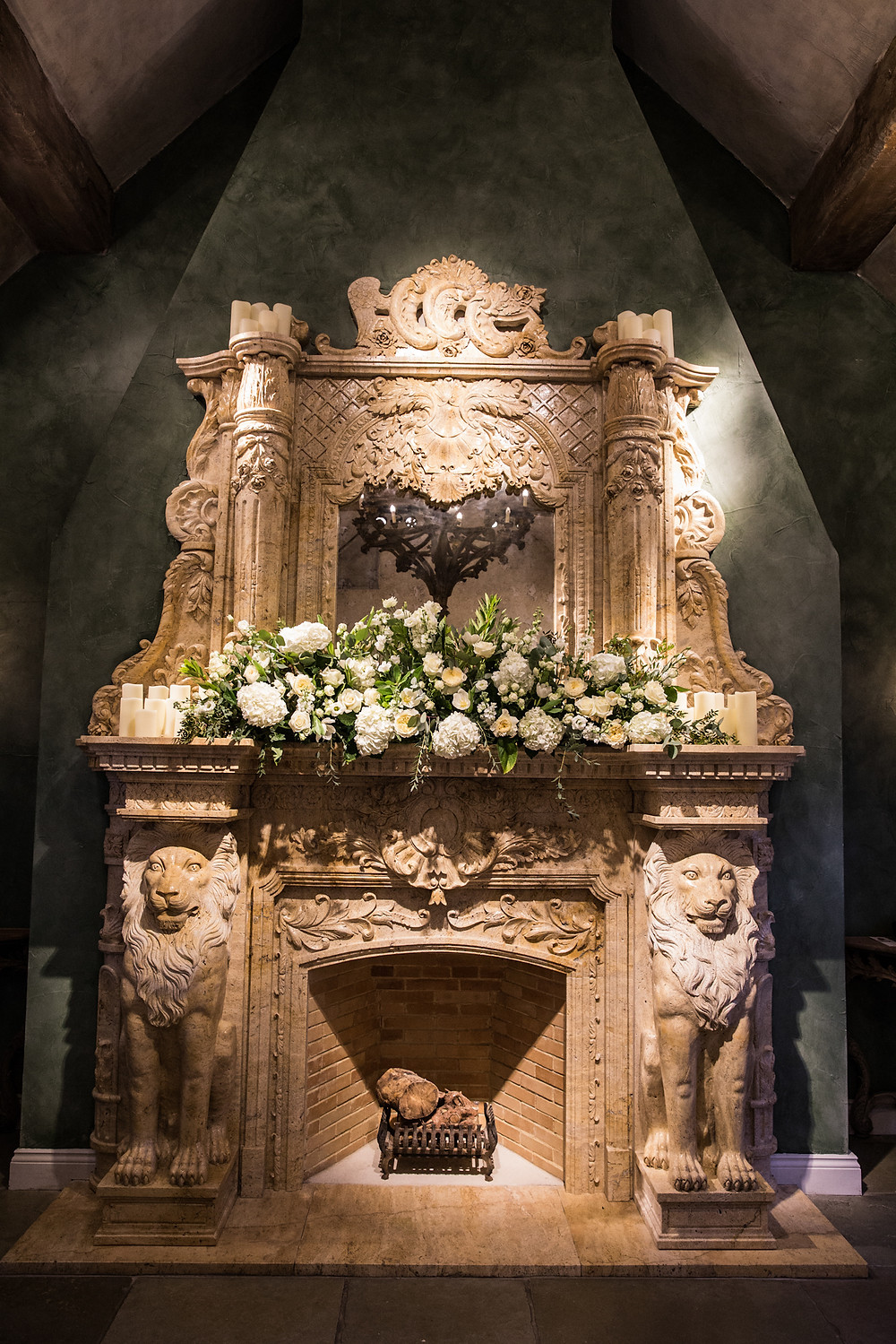 Le Petit CHateau Fireplace wedding ceremony dressed with white and green flowers