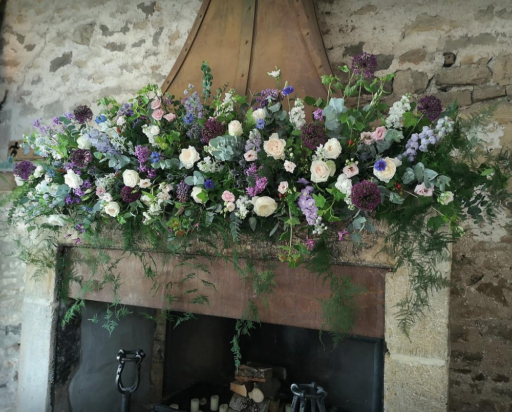 LArge Fireplace wedding flowers at ceremony room in Healey Barn in Northumberland