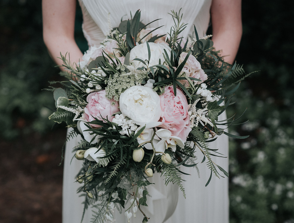 Bluch Pink and White Natural Hand Tied BRidal Bouquet at Jesmond Dene House wedding in Newcastle. Image by Eye on the Tyne.