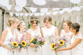 Colourful, summer Sunflower Bridal and Bridesmaid bouquets at Doxford Barns Northumberland