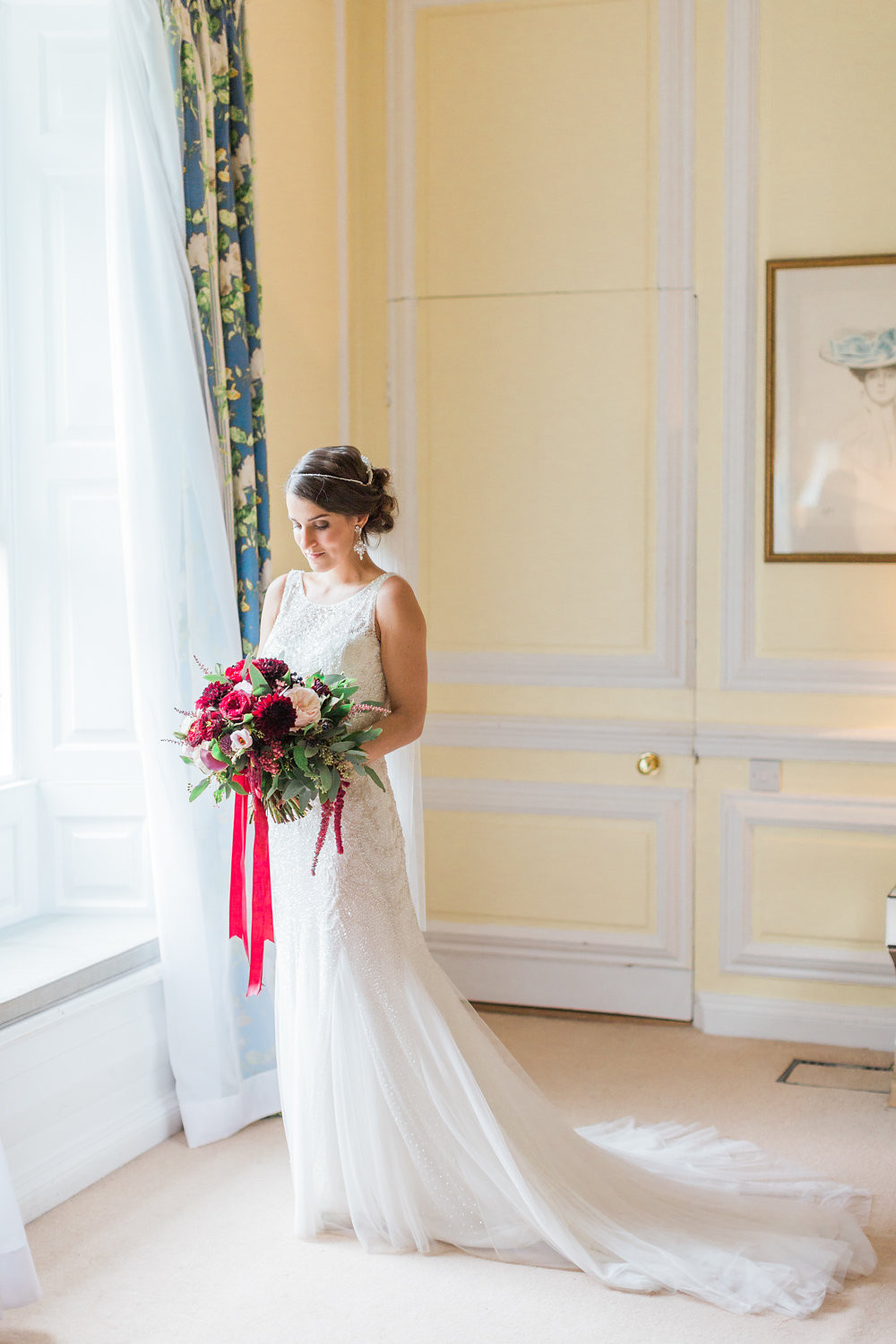 Dark red  and blush pink loose textured Bridal Bouquet at Eshott Hall Wedding in Northumberland. Image by Katy Melling