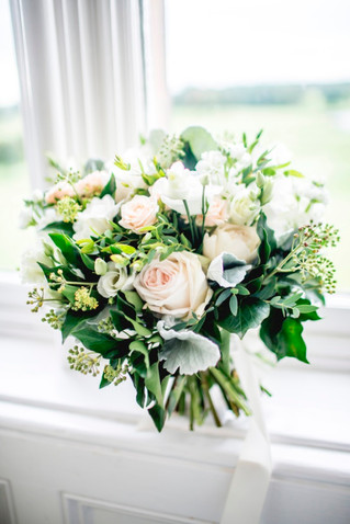 White and blush peach bridal bouquet flowers at Matfen Hall