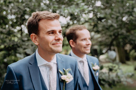 Blush buttonholes and blue suits at Crook Hall durham wedding