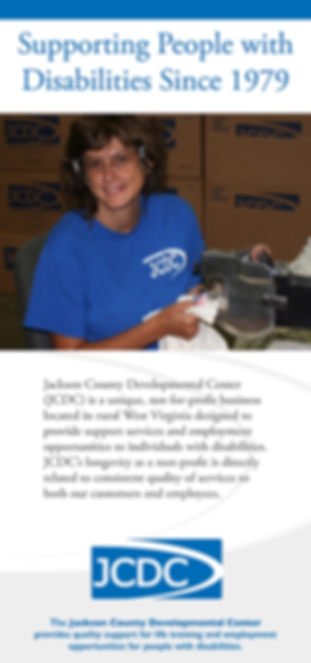 Debbie Starkey works for JCDC cutting cloths for cleaning.