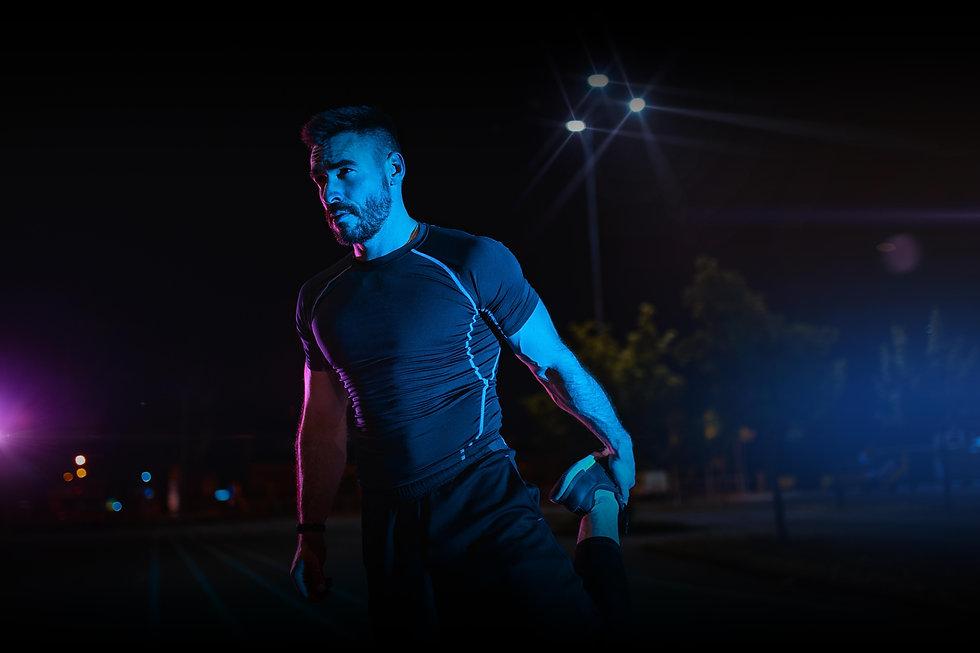 Man stretching night run.jpg