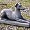 Thumbnail: Liggende hond van steen