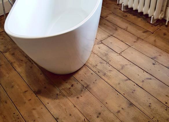 wooden floor in bathroom